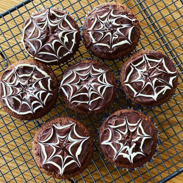 Get ready for Halloween with these dead-simple spiderweb cupcakes. They're one of the spooktacular recipes in the October box (alongside amazing ghost cookies and pumpkin scones). We only have a few boxes left - get in quick!  #halloween #halloweenbaking #baking #bakingwithkids #cupcakes #chocolate